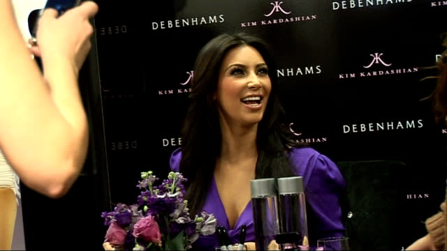 Kim Kardashian launches perfume at Debenhams on Oxford Street Various of Kardashian posing for photographs with fans chatting and signing autographs