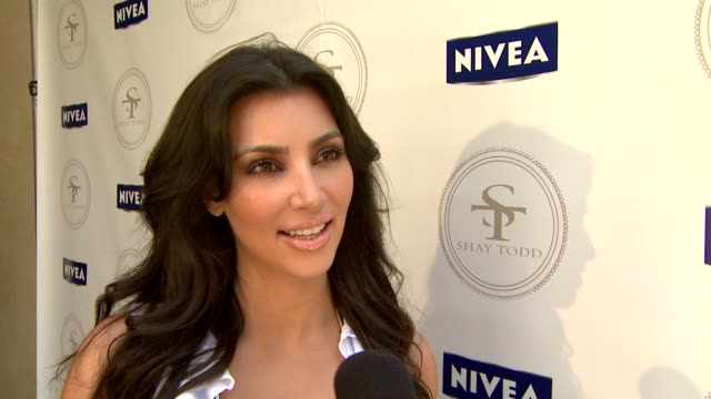 Kim Kardashian on her favorite thing about Memorial Day on why she's her today on the NIVEA/Shay Todd Bikini Bash on if she's having fun today and on...