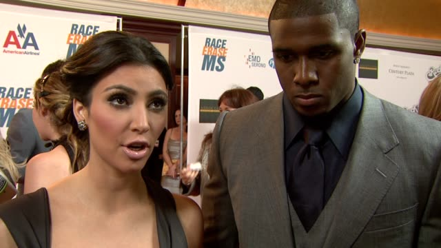 kim kardashian & reggie bush on being a part of the night, what she appreciates about the work nancy davis does for what they're most looking forward... - ナンシー デイヴィス点の映像素材/bロール