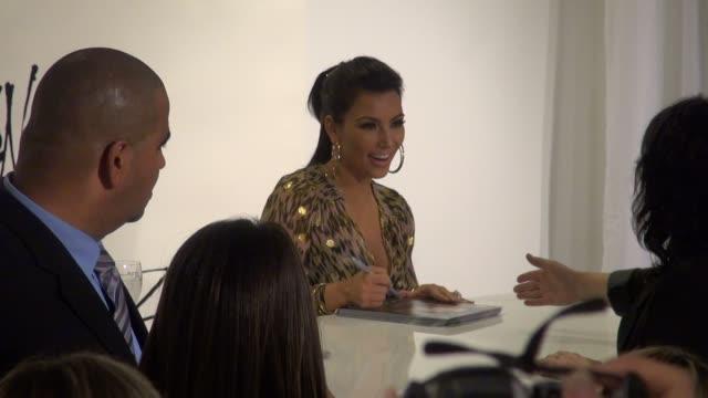 kim kardashian signs for fans at bloomingdales in new york 9/21/11 - bloomingdales stock videos & royalty-free footage
