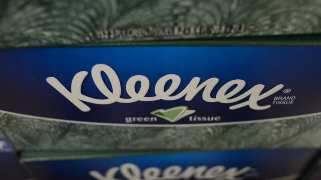Kimberly Clark Corp Kleenex brand facial tissues sit on display for sale at a supermarket in Princeton Illinois US Shots of Kimberly Clark cleaning...