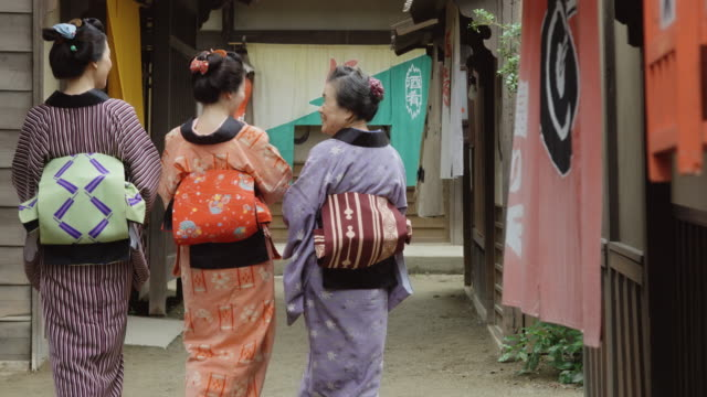 kimono wearing women walking away from camera in edo period village - 18th century stock videos and b-roll footage