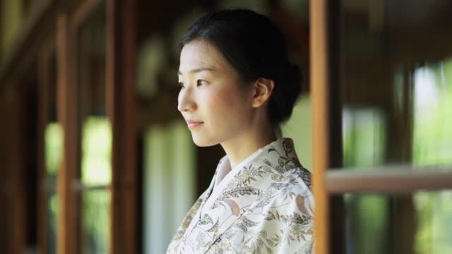 kimono woman turning to camera - kimono stock videos and b-roll footage