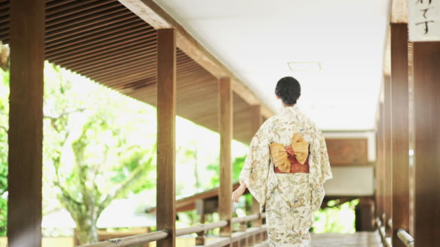 kimono-wearing woman walking away - kimono stock videos & royalty-free footage