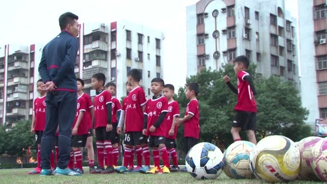 kin chai used to kick around a plastic jug instead of football in his rural chinese school but the 28 year old is now a coach working to develop... - jug stock videos & royalty-free footage