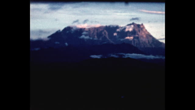 Kinabulu Mountain at dusk From the home movie collection of Jack Dennis Boles Boles spent 17 years in the Colonial Service in British North Borneo...