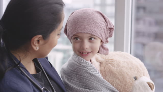 kind doctor comforts girl with cancer - cancer illness stock videos & royalty-free footage