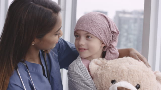 kind doctor comforts girl with cancer - illness stock videos & royalty-free footage