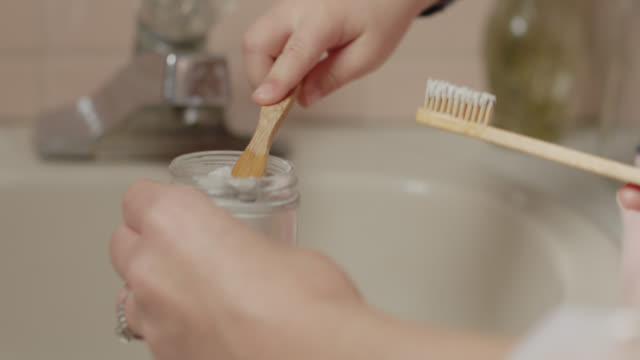 cu kind mother helps child put toothpaste on toothbrush - toothbrush stock videos & royalty-free footage