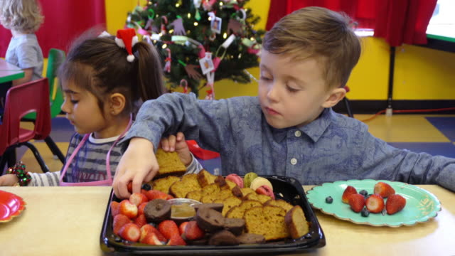 kindergarten christmas tree decoration preschool children group food party - preschool stock videos & royalty-free footage