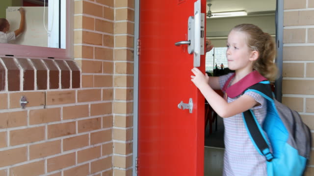 kindergarten primary school girl student arriving for class - preschool child stock videos & royalty-free footage