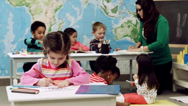 Kindergarten student at a desk working on schoolwork
