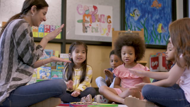kindergarten students in daycare - preschool stock videos & royalty-free footage