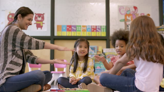 kindergarten students in daycare - teacher stock videos & royalty-free footage