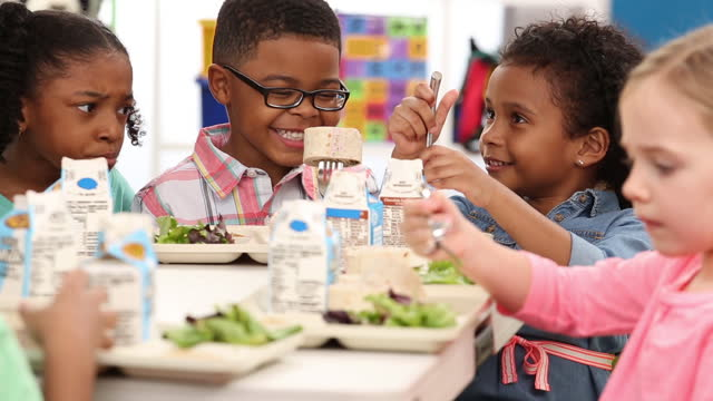 kindergarteners eating in school cafeteria - canteen stock videos & royalty-free footage