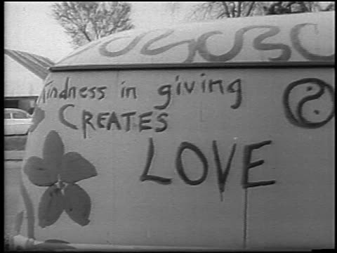 "kindness in giving creates love"" painted on side of van / belle isle, detroit / newsreel - hippy stock videos & royalty-free footage"
