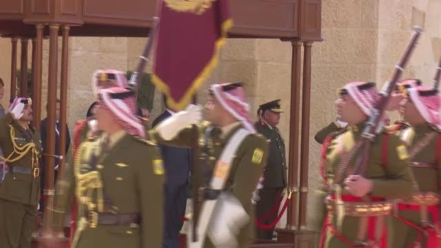 King Abdullah II of Jordan and German President FrankWalter Steinmeier review the Royal Guards of Honor before their meeting at AlHusseinya Palace in...