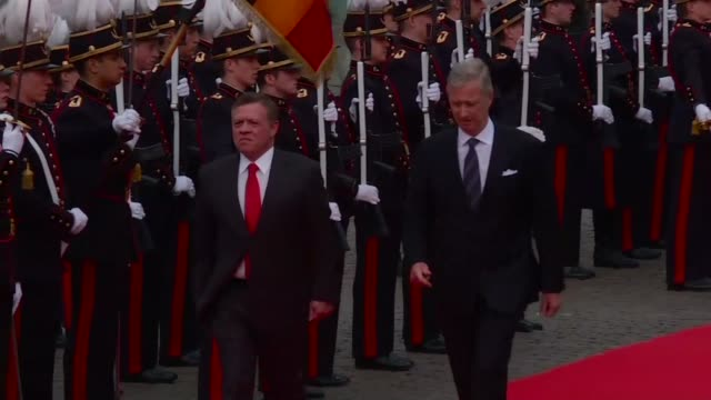 King Abdullah II of Jordan and his wife meet the Belgian King and Queen on an official visit to Brussels