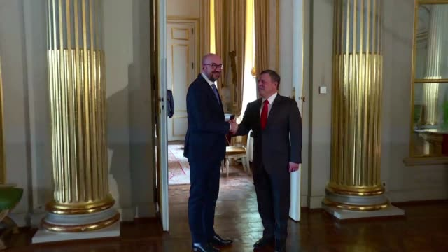 King Abdullah II of Jordan shakes hands with Belgian Prime Minister Charles Michel at the Royal Palace the Kings official visit to Brussels