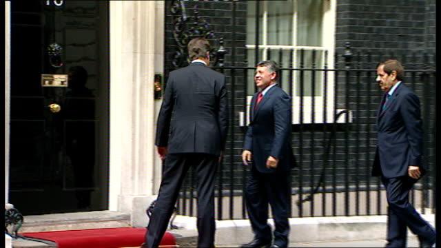 King Abdullah II of Jordan visits Downing Street ENGLAND London EXT Car pulls up and King Abdullah II of Jordan gets out / David Cameron MP greets...