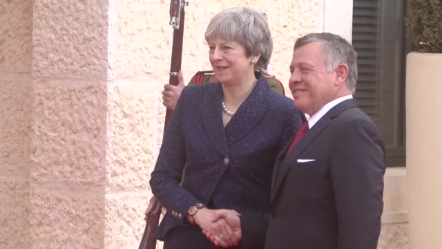 King Abdullah II of Jordan welcomes British Prime Minister Theresa May with an official welcoming ceremony and two leaders hold a a meeting at the...