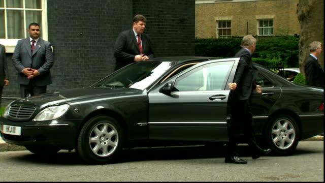 King Abdullah Of Jordan arrives at Downing Street ENGLAND London Downing Street EXT Car along / King Abdullah Of Jordan out of car / Abdullah shaking...
