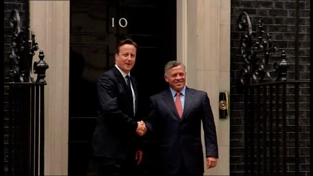King Abdullah Of Jordan meeting with David Cameron ENGLAND London Downing Street PHOTOGRAPHY** Car along / King Abdullah Of Jordan out of car /...