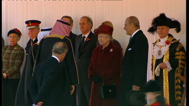 King Abdullah of Saudi Arabia state visit to Britain Back View King Abdullah Bin Abdul Aziz Al Saud of Saudi Arabia out of car and greeted by Queen...