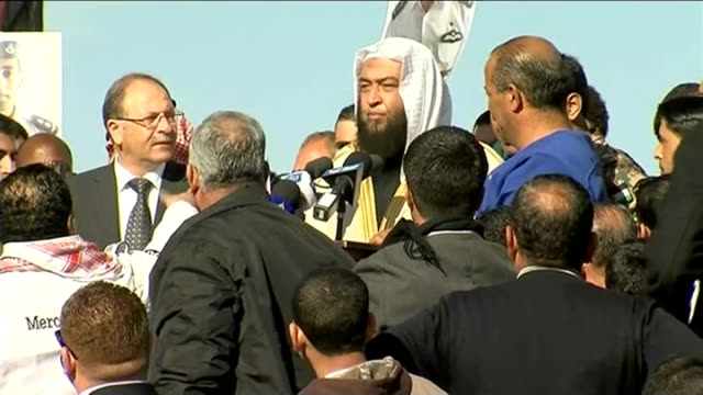 King Abdullah promises retribution for Jordanian pilot murdered by Islamic State Amman Crowd at rally and image of Moaz alKasasbeh held up in crowd...