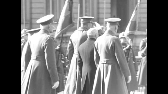 King Albert I walks long line of soldiers saluting during celebration of 17th anniversary of the Battle of Yser/ veterans march towards camera some...