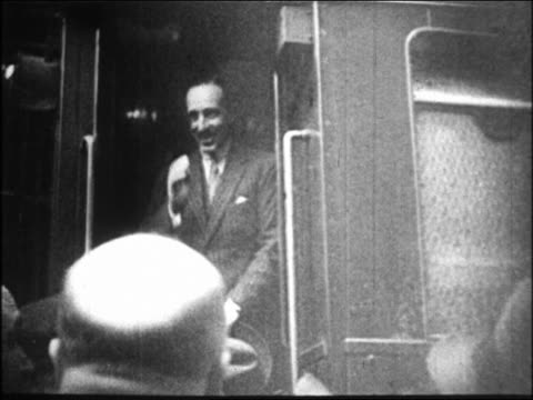 king alfonso xiii standing in doorway of train pulling away / crowd in foreground / spain - 1931 stock videos & royalty-free footage