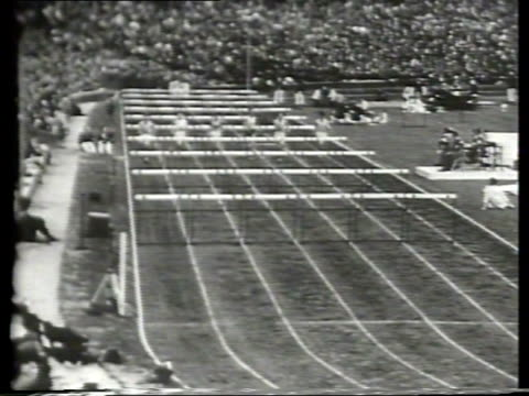 vidéos et rushes de king and queen of england attend the 1948 london olympics in wembly stadium / athletes race from the start line for the 110 meter hurdle event / slow... - raconter