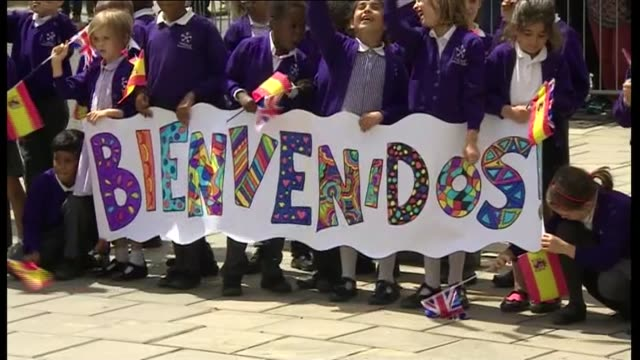 Lunch and speech at Divinity School Oxford ENGLAND Oxfordshire Oxford EXT Children cheering and waving Spanish flags / King Felipe VI and Queen...