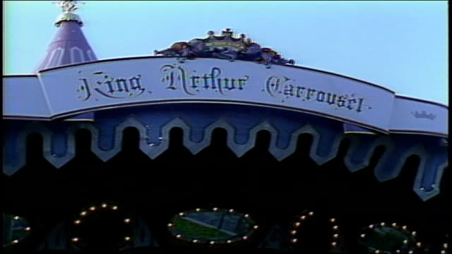 king arthurs carrousel and sign in anaheim, california - anaheim california stock videos & royalty-free footage