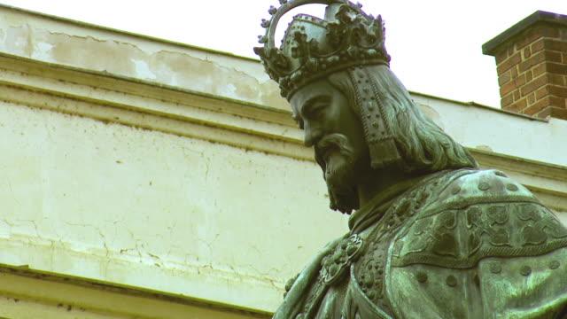 cu tu king charles iv statue / prague, czech republic - tschechische kultur stock-videos und b-roll-filmmaterial