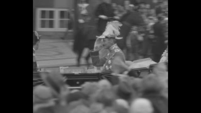 ms king christian x and queen alexandrine ride in royal carriage through crowds of loyal subjects king salutes interspersed with vs cheering crowds /... - danimarca video stock e b–roll