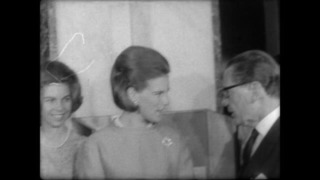 King Constantine arrives at UN headquarters and is greeted by Secretary General U Thant / CU Queen Ann Marie / tour empty assembly room / outside...