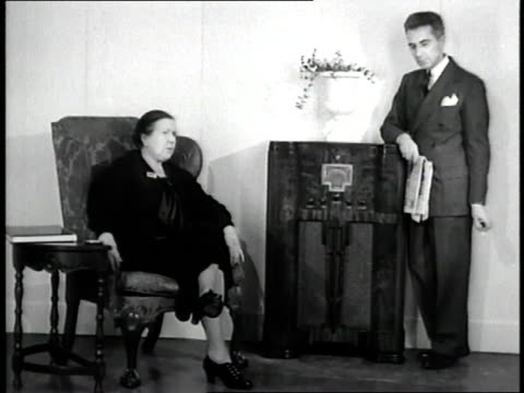 king edward viii gives a speech declaring his abdication while civilians listen over the radio - edward viii stock videos & royalty-free footage