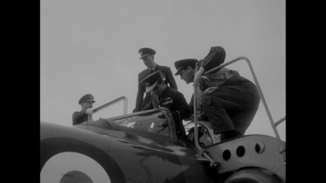 vídeos de stock e filmes b-roll de king faisal ii of iraq on tarmac with british raf officer shakes hands with airmen standing at attention / wide shot of raf fighter plane on tarmac /... - visita