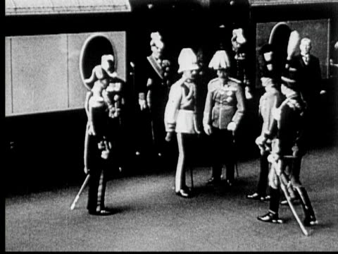 b/w 1927 montage ms ws pan king faisal of iraq greeted by king george and his sons then riding in stagecoach through city streets, london, england - 1927 stock videos & royalty-free footage