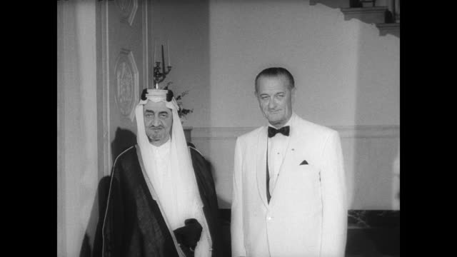 king faisal of saudi arabia arrives at the white house for three day state visit / greeted by president lyndon johnson / johnson and faisal walk past... - state dinner stock videos and b-roll footage