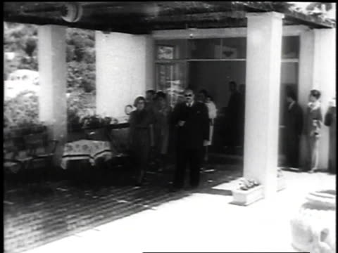 king farouk in exile with wife and infant son after being ousted shown walking out of building and sitting together - 1952 bildbanksvideor och videomaterial från bakom kulisserna