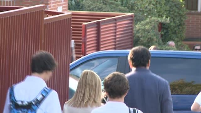 King Felipe VI of Spain and Queen Letizia of Spain leave 'Santa Maria de los Rosales' school in the first day of school