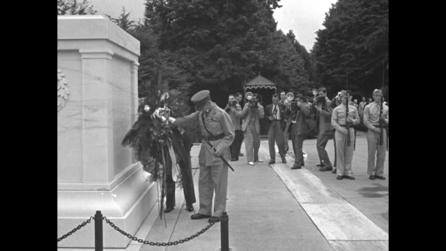 king george ii of greece arrives at arlington national cemetery and lays a wreath at the tomb of the unknown soldier during his visit to the us... - バージニア州マウントヴァーノン点の映像素材/bロール