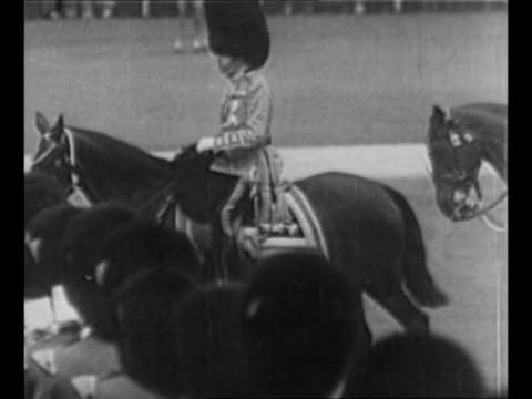 king george v lays wreath at the cenotaph in london in 1927 / king wears coldstream guard uniform as he rides horse during trooping the colour... - prince stock videos & royalty-free footage