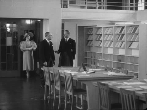 king george vi and queen elizabeth are shown around the medical library during their tour of the new national institute for medical research at mill... - queen dowager stock videos & royalty-free footage
