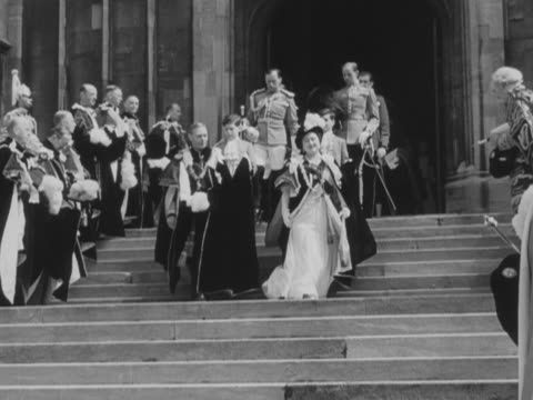 king george vi and queen elizabeth leave st george's chapel at windsor castle following the completion of the order of the garter ceremony - gutes benehmen stock-videos und b-roll-filmmaterial