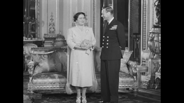 king george vi and queen elizabeth pose in room of buckingham palace / closer view of couple george in naval uniform / george / note exact month/day... - 1952 stock videos and b-roll footage