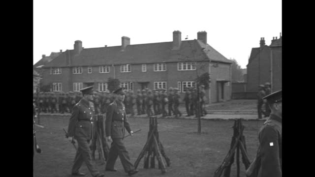 king george vi on grounds of infantry training center as soldiers come to attention and march / king watches as soldier stabs sack with bayonet /... - bayonet stock videos & royalty-free footage