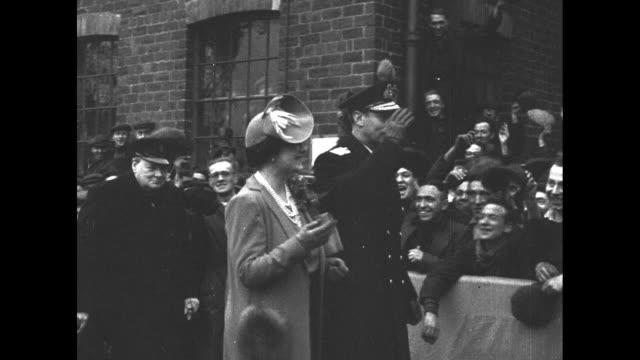 king george vi queen elizabeth and british prime minister winston churchill arrive for launch of hms duke of york in clydebank scotland / ws bottle... - ship launch stock videos & royalty-free footage